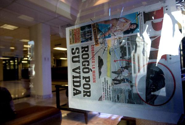 Gunmen fire newspaper