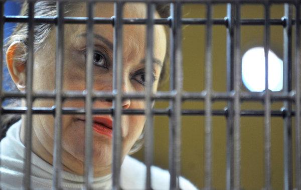 Elba behind bars